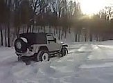 Jeep Wrangler TJ Rubicon playing in the snow