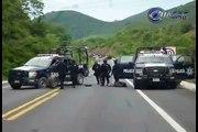Mueren 2 policías federales y 20 delincuentes en enfrentamientos en Michoacán