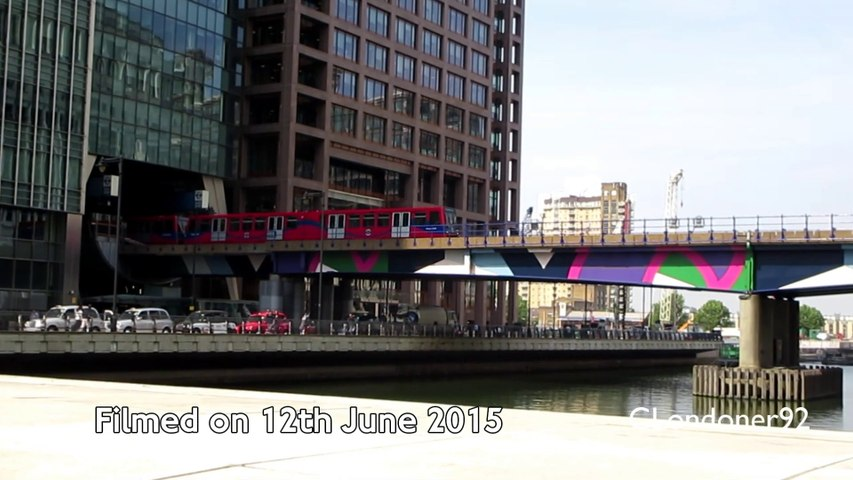 DLR train crossing Middle Dock at Canary Wharf East London