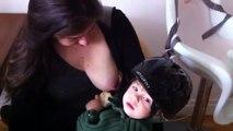 Baby eats bagel and nurses in bike helmet