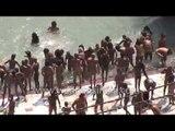 Naga sadhus taking sacred dip in river Ganges : Kumbh mela