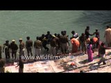 Hindus bathe in a sacred river Ganges during Maha Kumbh Mela