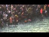 Hindu devotees gather to bathe in river Ganges during the Kumbh Mela - Haridwar