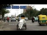 Delhi traffic at Maharani Bagh Ring Road: auto and cycle rickshaws