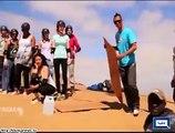 Instead Of Snowboarding, People Enjoying Sandboarding