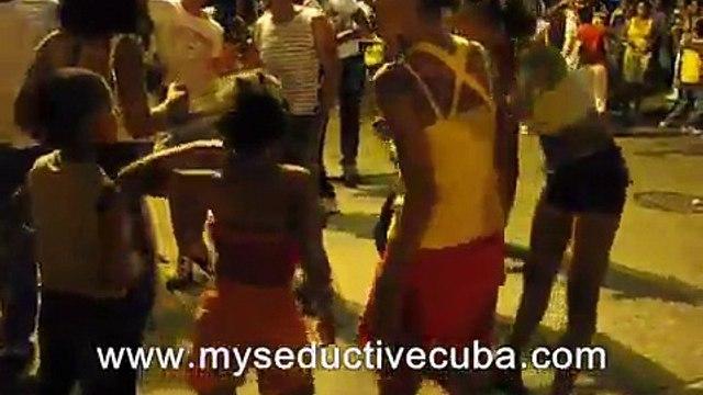 Cuban girls dancing on the streets in Santiago carnival - Cuba