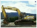 Kobelco Excavator SK210HD Makes Path In The Edge Of Forest