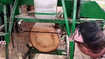 Cutting big logs with the homemade sawmill.