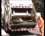 Leach Schorling 2R rear loader garbage truck eats furniture