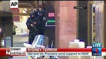 Hostages Seen Fleeing Australian Cafe