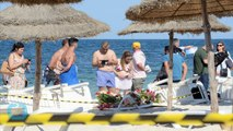 Defiance Mixed With Sadness As Tourists Return to Tunisian Beach