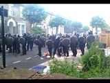 Youths and police face off in Hackney