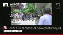 Les Grecs patientent devant les distributeurs automatiques pour retirer de l'argent
