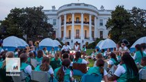 Some lucky Girl Scouts got to sing songs with Obama and camp in his yard