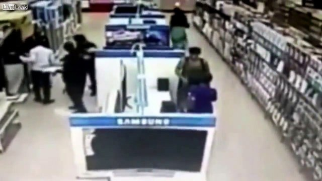 Woman Caught Putting An LCD TV Under Her Skirt from Samsung Display Center