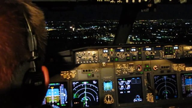 Cockpit view of night landing rwy 07 BBU 737-800
