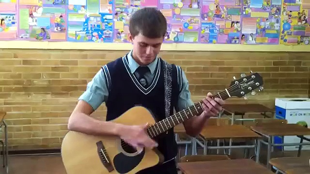 A very talented guitar player! Just showing a trick he mastered..