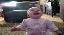 Baby laughing at popcorn eating dog!
