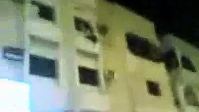 Man throws wife from building