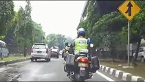 2 Indonesian police motorcycles escorting a convoy of cars - 1