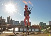 Unicyclist Plays the 1812 Overture on a Flaming Bagpipe