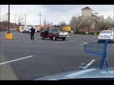 Kung fu man in parking lot. Music by Hans Zimmer
