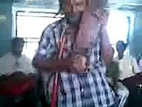 India: Organ grinder of sorts on an Indian train