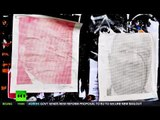 Italian 'Banksy' exposes surveillance chiefs in street art