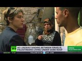 Israelis, Palestinians share house in Hebron, separated by brick wall