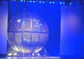 Performing Motorcyclists Spin in Huge Metal Ball