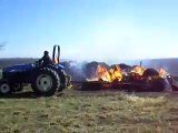 Hay bales burning in a grass fire