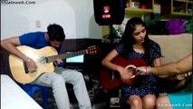 MUSICOS CANTANTE CANTA CANCION CON GUITARRAS EN UN DUO DE TROVA FAMILIAR EN LA SALA DE SU CASA JULIO 2015