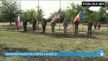 500 de militari din Moldova şi din câteva ţări membre NATO îşi demonstrează forţa la Bălţi. Astăzi, pe poligonul din oraş, au început exerciţii la care participă soldaţi din ţara noastră, România, Georgia, Statele Unite şi Polonia.