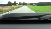 Moose and calf cross road in front of car near Eidsvoll, Norway (moose cross 5: 10 in video)