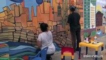 I muri dell'odio di Karachi ricoperti dai graffiti degli artisti