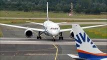 ANA Boeing 787-8 landing and taxi at Düsseldorf+Emirates Boeing 777-300(ER) takeoff