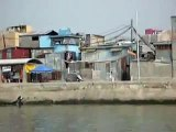 Driving by Pasig riverferry through the slums in Manila Philippines