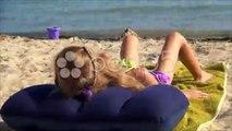 Little Girl in Sea Sand Beach, Coastline, Child Sunbathing on Seashore, Children. Stock Footage