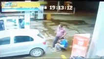 LiveLeak - Father getting petrol with his daughter shoots and kills an armed robber-copypasteads.com