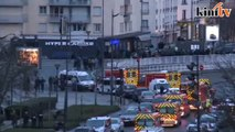 Charlie Hebdo suspects killed as twin sieges shake France