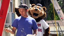 MN Twins mascot TC helps with painting instructions for Twin Cities Habitat