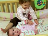20 month old trying to change her 5 month old baby sisters diaper!!