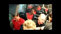 Lucky Manchester United fans invited on to the team coach.