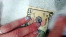 Lavez ce billet de 50 et vous aurez 10$!! Fausse monnaie américaine...
