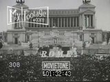 Stock Footage - 1936 ROME: IL DUCE MUSSOLINI GIVES SPEECH FROM BALCONY IN ODD HAT