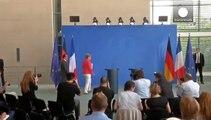 ميركيل وهولاند يدعوان إلى سياسة أوروبية موحَّدة بشأن الهجرة واللجوء
