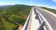 Watch In Awe As This Man BASE Jumps Off A Bridge From A MOVING...