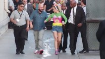 Smiley Miley Cyrus Hops Round To Visit Jimmy Kimmel