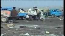 Iraqi Children eke out a living in Baghdad rubbish dump - Iraq War