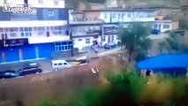 Vehicles Washed away as Road Collapses into River *Volume*